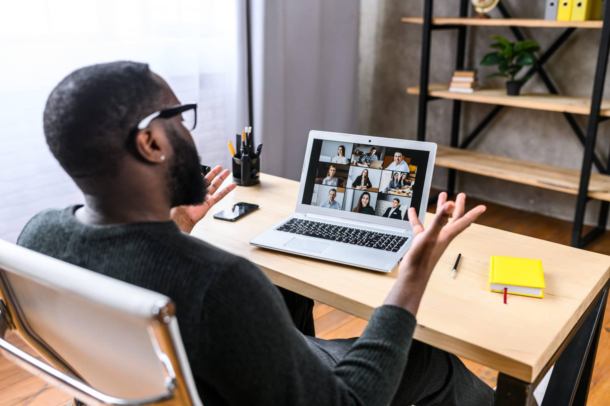 man shrugs in team online employee training