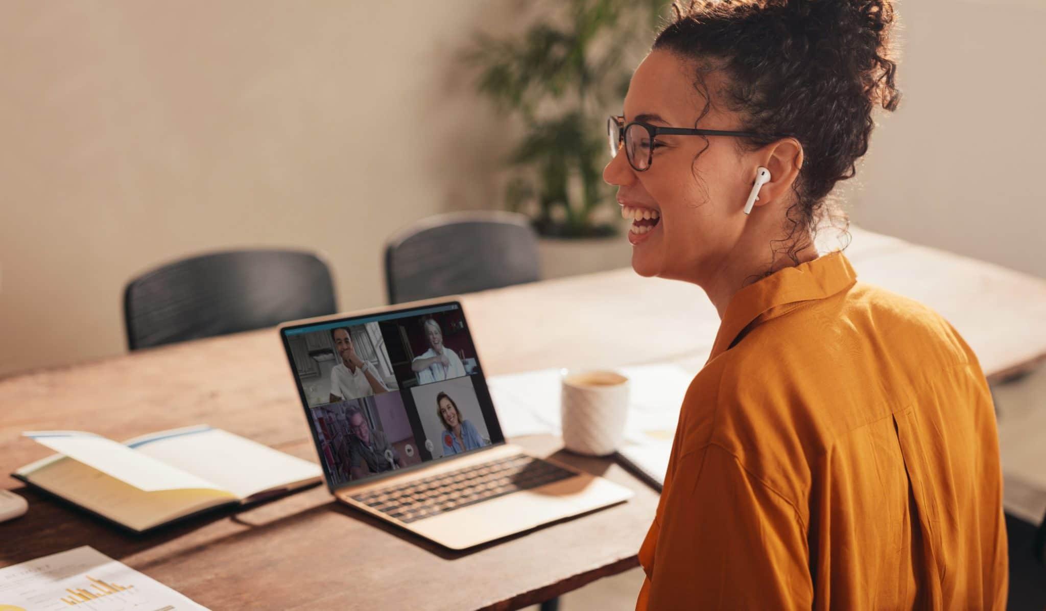 women laughing trying virtual team meeting ideas
