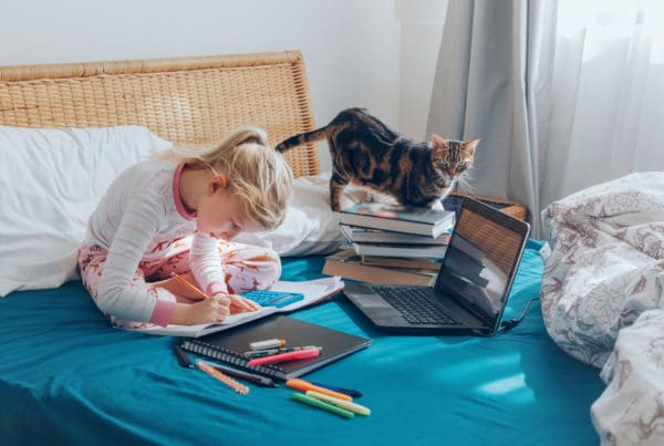 young girl learning through virtual academies