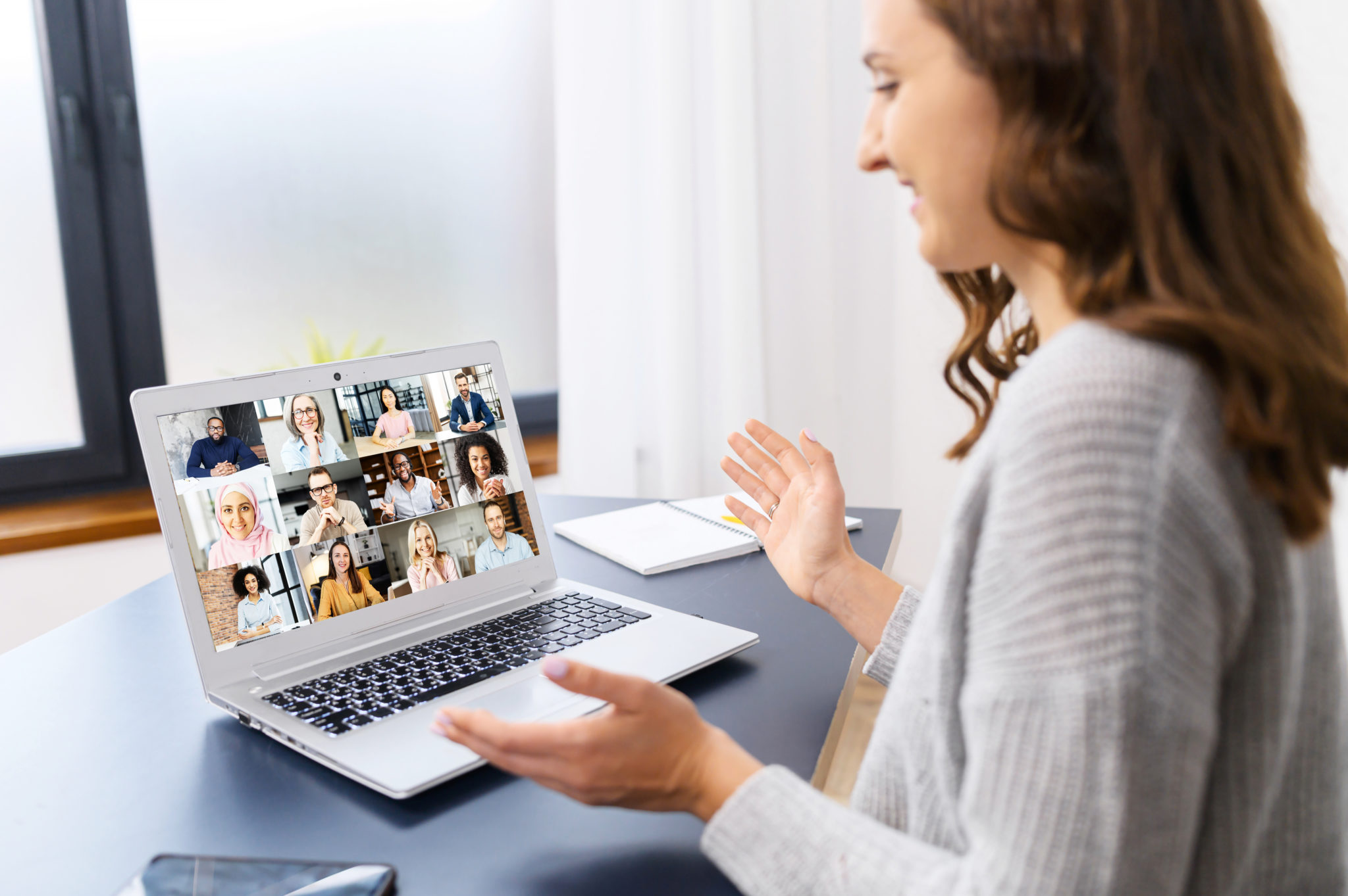 woman talking to team during virtual team icebreakers