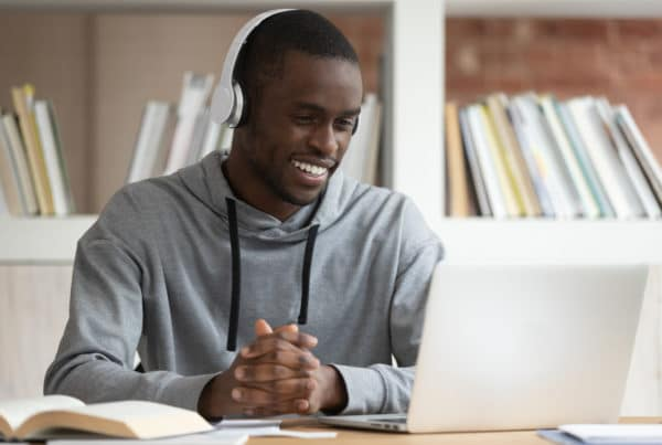 boy at his computer for colleges using zoom